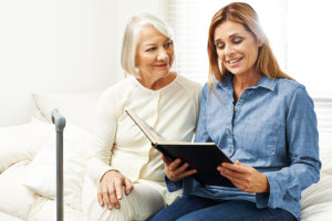 caregiver reading stories to her patient