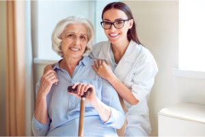 young nurse with elderly patient at the nursing home